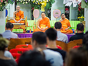 20 AUGUST 2015  - BANGKOK, THAILAND:  Buddhist monks lead a chanting service at the funeral for Yutnarong Singraw Thursday. More than 100 people gathered at Wat Bang Na Nok in Bangkok for the third day of the funeral rites for  Yutnarong Singraw, a Thai man who was killed in the bombing at the Erawan Shrine in Bangkok Monday. Yutnarong was delivering legal documents when the blast occurred. More than 20 people were killed and more than 100 injured in the blast.       PHOTO BY JACK KURTZ