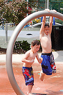 Eli Taylor, 4 (left) and Bryce, 8 at Orchardly Park in Oakwood, Sunday, June 9, 2013.