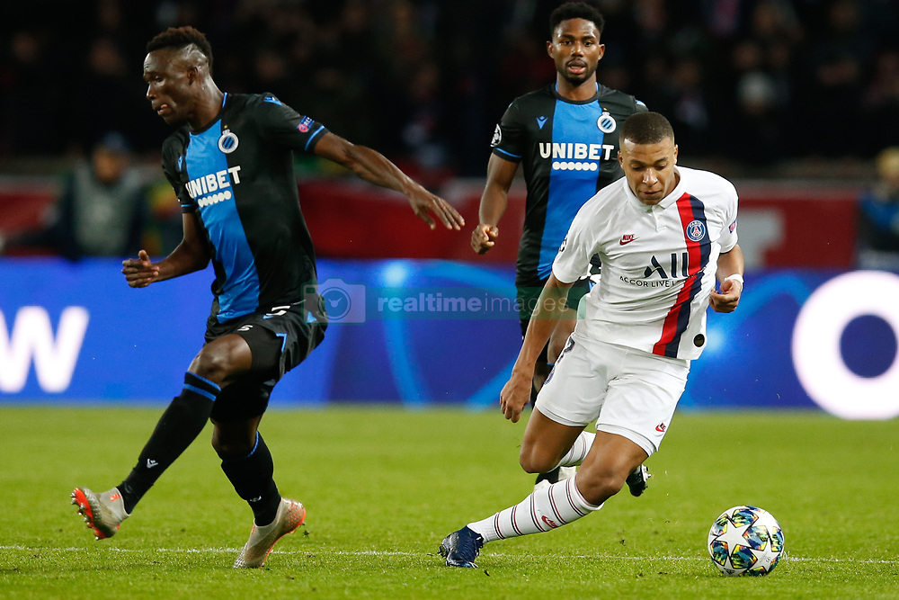 November 6, 2019, Paris, France: Club's Odilon Kossounou and PSG's Kylian Mbappe fight for the ball during the match between French club Paris Saint-Germain Football Club and Belgian soccer team Club Brugge KV, Wednesday 06 November 2019 in Paris, France, on day four in Group A, in the first round of the UEFA Champions League. (Credit Image: © Bruno Fahy/Belga via ZUMA Press)