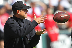 Sept 30, 2012; East Rutherford, NJ, USA; San Francisco 49ers head coach Jim Harbaugh catches a pass from San Francisco 49ers quarterback Alex Smith (11) before the game between the New York Jets and the San Francisco 49ers at MetLIfe Stadium.