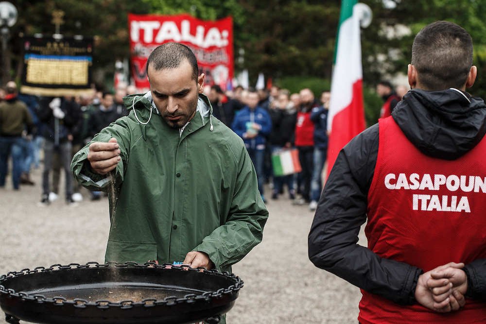 23.5.2015, Gorizia, Italy<br /> <br /> Gathering soil from whole Italy<br /> <br /> Rally of neofascists from whole Italy in Gorizia at 100. anniversary of entry of Italy into the 1st World War organised by fascistic movement Casa Pound. All fascist groups brought soil from different parts of Italy to celebrate 1. WW. They marched in silence, but everyone who was present at rally could feel dim and creepy atmosphere.<br />  After the end of 1. World War Italy litteraly enslaved, tortured and changed names of Slovenian people to Italian names in Primorska region. On  July 13. 1920 Italian fascists burned down Slovenian National home in Trieste and about 21 different buildings, offices, apartments, banks, printing offices, warehouses and pubs. Interresting was that, that official government didn`t arrest none of raging demonstrants. After that fascists(from 1920 to 1941 killed almost 40 000 Slovenes in Primorska region. Italy even today denies genocide over Slovene population in Primorska region and tries to hide its role during 2. World War by silence about this part of history in their history books. That`s the main reason why in Italy young people again embrace fascits ideology.