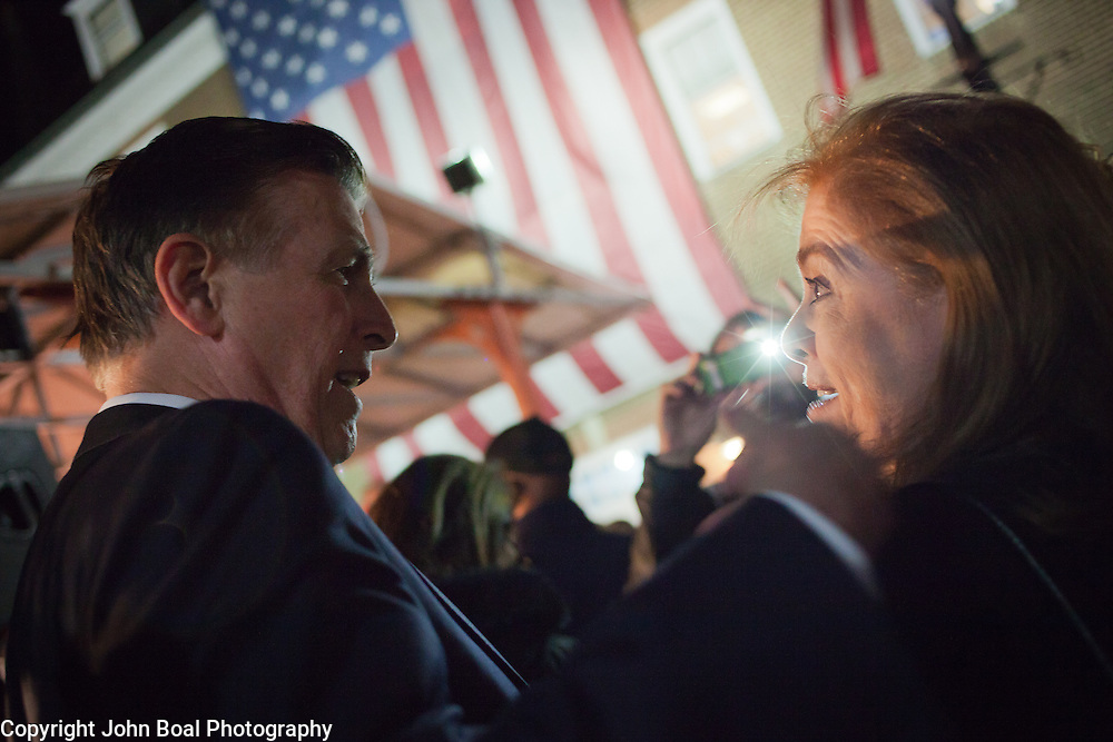 Don Beyer, candidate for the 8th District Congressional seat in Virginia speaks with a supporter following a Democrat get out the vote (GOTV) rally at Market Square in Old Town Alexandria, VA, on  Monday, November 3, 2014, the day before Election Day.  John Boal Photography