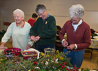 Eleanor Brouillard, Eleaner Swain and Beverly Clarenbach put together centerpieces with the Opechee Garden Club at the Weirs Community Center on Tuesday.  (Karen Bobotas/for the Laconia Daily Sun)
