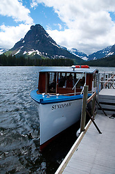 Sinopah Tour Boat Under Sinopah Peak on Two Medicine Lake, Glacier National Park, Montana, US