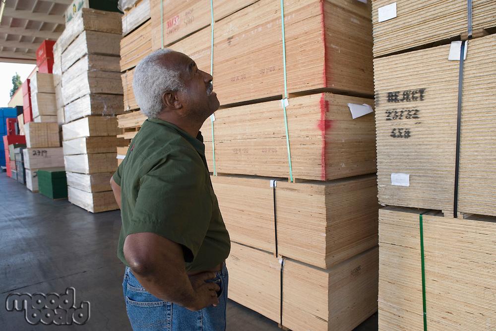 Senior man in warehouse
