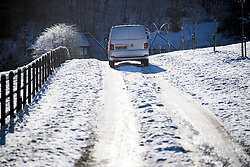 © Licensed to London News Pictures. 30/01/2019. Butlers Cross, UK.  A van drives up a snow covered road near Butlers Cross, Buckinghamshire, as snow hits the south east of England. Photo credit: Ben Cawthra/LNP