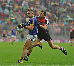 Mayo's Chris Barrett tries to disposess James O'Donoghue during the All Ireland Semi Final against Kerry at Croke Park.<br /> Pic Conor McKeown