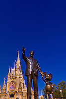 Partners Statue (Walt Disney and Mickey Mouse) with Cinderella's Castle in background, Disney World, Orlando, Florida USA
