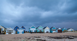 © Licensed to London News Pictures. 06/01/2014. Mudeford Spit, Christchurch, Dorset, UK. Heavy rain passes over the beach huts on Mudeford Spit near Christchurch in Dorset, UK. The beach huts sell for an average of around £140,000. Dorset is expected to be one of the worst affect areas, with more heavy rain and flooding forecast. Photo credit : Rob Arnold/LNP