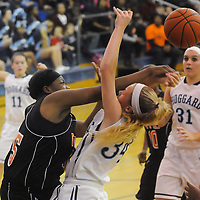 Hoggard's Emma Haywood has a shot blocked by New Hanover's Nyasia Waddell Friday December 12, 2014 at Hoggard High School in Wilmington, N.C. (Jason A. Frizzelle)