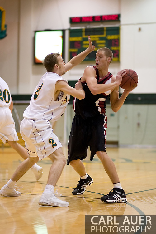 1/6/2006: Senior guard Buddy Bailey (2) of the UAA Seawolves gets into the face of Bryce Daub of the Central Washington Wildcats as Anchorage goes on to beat the visiting Central Washington Wildcats, 80-60 at the Wells Fargo Sports Complex on the campus of UAA.<br />