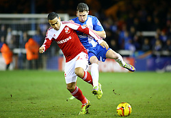 Peterborough United's Danny Swanson in action with Swindon Town's Louis Thompson - Photo mandatory by-line: Joe Dent/JMP - Tel: Mobile: 07966 386802 05/02/2014 - SPORT - FOOTBALL - Peterborough - London Road Stadium - Peterborough United v Swindon Town - Johnstone's Paint Trophy
