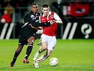 24-11-2007: Voetbal:AZ-WILLEM II: ALKMAAR<br /> Rydell Poepon in een duel met Sebastien Pocognoli<br /> Foto: Geert van Erven