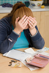 Woman looking stressed budgeting,