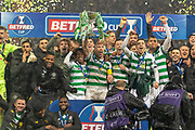 Celtic Captain Scott Brown Lifts the Betfred Scottish League Cup and celebrates alongside his team mates at Hampden Park, Glasgow, United Kingdom on 8 December 2019.