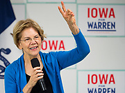 "26 NOVEMBER 2019 - KNOXVILLE, IOWA: US Senator ELIZABETH WARREN (D-MA) holds up two fingers while talking about her proposed two percent ""wealth tax"" to a crowd of about 90 people during a campaign event in Knoxville Tuesday. Sen. Warren hosted a community meeting at the Sprint Car Hall of Fame and Museum in Knoxville, IA. She is running to be the Democratic candidate for the US Presidency in the 2020 election. Iowa hosts the first selection event of the presidential election season. The Iowa caucuses are February 3, 2020.                    PHOTO BY JACK KURTZ"