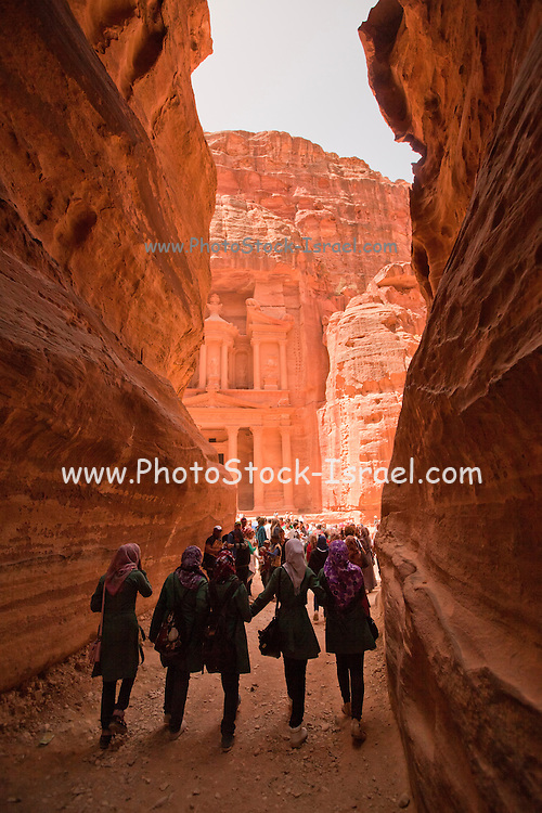 Middle East, Jordan, Petra, UNESCO World Heritage Site. The Treasury El-Khazneh, as seen from the end of Al-Siq The main entrance into the city. A 1207 metres long 3 to 16 metres wide and 100 Meters high natural gorge.