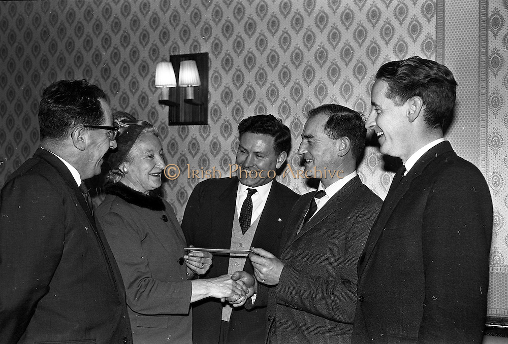 28/01/1963<br /> 01/28/1963<br /> 28 January 1963<br /> Esso National Roadside Gardens Competition Awards presented at the Anchor Hotel, Parnell Square, Dublin. Esso Petroleum Company (Ireland) Ltd. presented awards to the Dublin District winners in the Garage and Service Station Section of the competition in conjunction with Bord Failte.  Picture shows: Mr M.J. Brickey, Esso Area Manager; Mrs Ena Goosan; Mr J.H. Donovan, Director Esso; Mr T.P. Downey, Esso District Manager and Mr J.A. O'Brien, An Bord Failte.