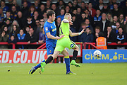 AFC Wimbledon defender Sean Kelly (22) tackling Peterborough United atacker Marcus Maddison (11) during the EFL Sky Bet League 1 match between AFC Wimbledon and Peterborough United at the Cherry Red Records Stadium, Kingston, England on 17 April 2017. Photo by Matthew Redman.