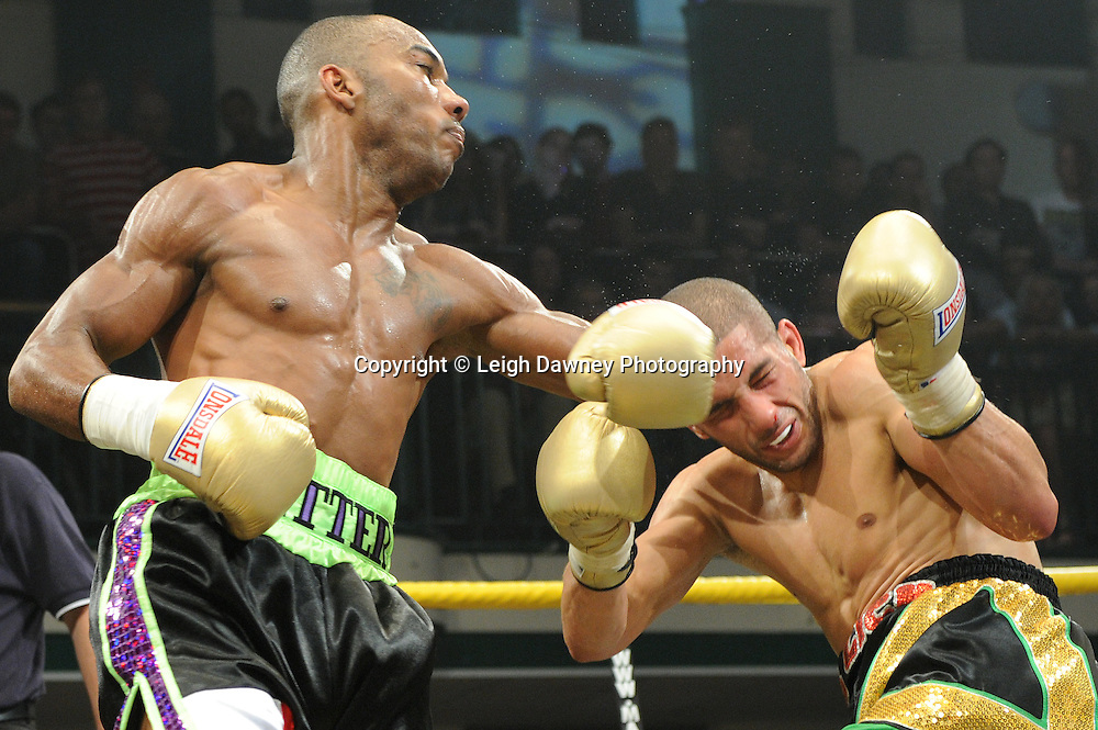 Junior Witter (black/green shorts) defeats Nathan Graham at Quarter Final Two at Prizefighter Welterweights II,York Hall, Bethnal Green ,London. Matchroom Sport/Prizefighter.Photo credit: Leigh Dawney 2011 07.06.11