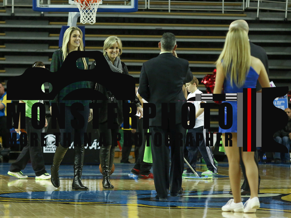 Delaware native and Chicago Sky reigning WNBA Rookie of the Year Elena Delle Donne &quot;LEFT&quot; and her Mother Joanie Delle Donne walk onto the court to receive special 87ers Lyme disease awareness game jersey Monday, Feb. 10, 2014 at The Bob Carpenter Sports Convocation Center, Newark, DE<br />  <br /> The proceeds raised will be donated to LymeAid 4 Kids of the Lyme Disease Association, Inc., a financial resource for the families of children who have been diagnosed with Lyme disease.