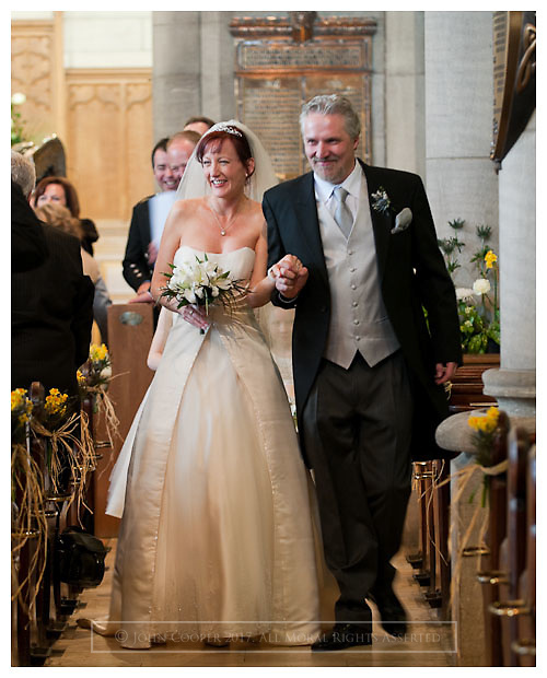 Bride and Groom leaving Church after wedding ceremony at Peebles Old Parish Church.