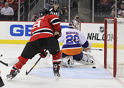 Mar 8; Newark, NJ, USA; New Jersey Devils left wing Ilya Kovalchuk (17) scores a goal on New York Islanders goalie Evgeni Nabokov (20) during the second period at the Prudential Center.