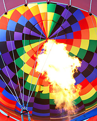 Hot air balloon readies for take off as the fire shoots into the balloon.