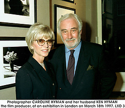 Photographer CAROLINE HYMAN and her husband KEN HYMAN the film producer, at an exhibition in London on March 18th 1997.LXD 3