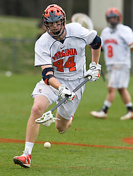 Virginia Cavaliers LSM Mike Timms (44) scoops up a loose ball in action against UMD.  The #9 ranked Maryland Terrapins fell to the #1 ranked Virginia Cavaliers 10 in 7 overtimes in Men's NCAA Lacrosse at Klockner Stadium on the Grounds of the University of Virginia in Charlottesville, VA on March 28, 2009.