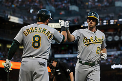 SAN FRANCISCO, CA - AUGUST 13: Stephen Piscotty #25 of the Oakland Athletics is congratulated by Robbie Grossman #8 after hitting a home run against the San Francisco Giants during the fifth inning at Oracle Park on August 13, 2019 in San Francisco, California. The San Francisco Giants defeated the Oakland Athletics 3-2. (Photo by Jason O. Watson/Getty Images) *** Local Caption *** Stephen Piscotty; Robbie Grossman