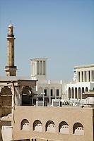 UAE, Dubai, old windtowers and minaret of the Grand Mosque in Bur Dubai