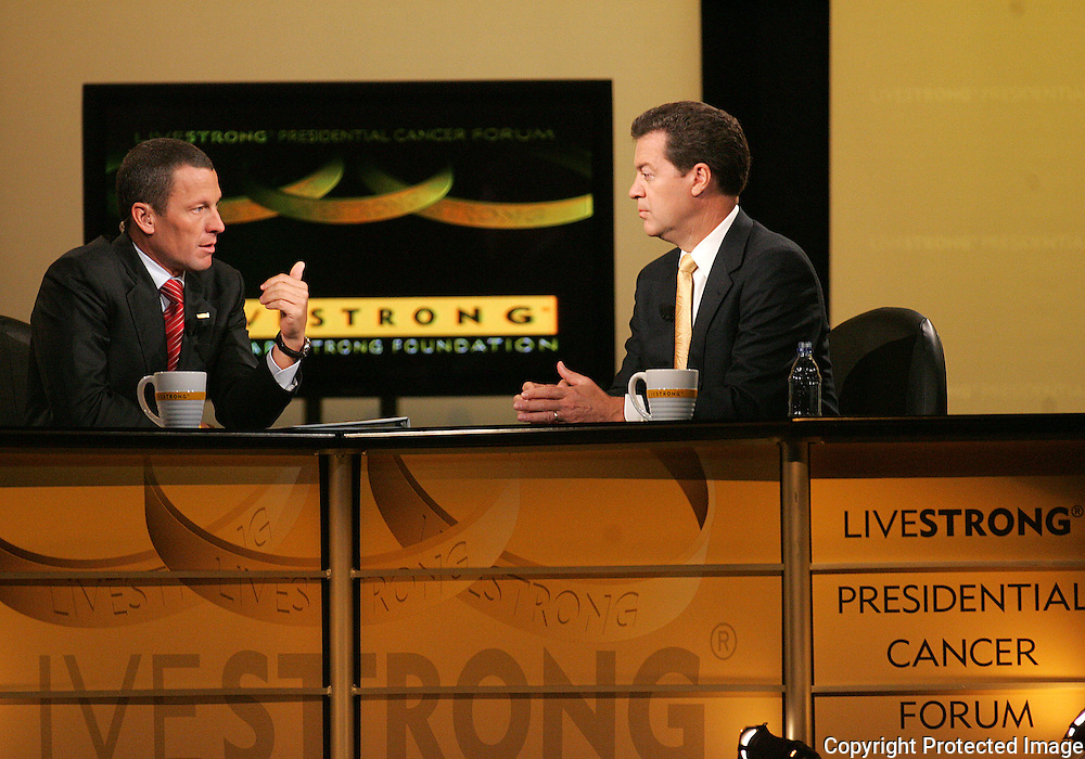 28 August 2007: Seven-time Tour de France winner Lance Armstrong (left) asks a question to Republican presidential hopeful and Senator Sam Brownback (R-KS) (right) at the LIVESTRONG Presidential Cancer Forum in Cedar Rapids, Iowa on August 28, 2007.