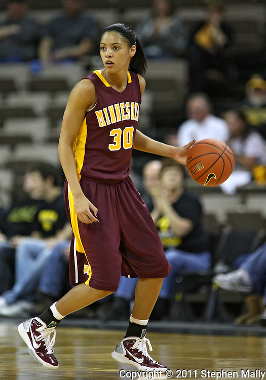 February 10 2011: Minnesota Golden Gophers guard Kiara Buford (30) with the ball during the first half of an NCAA women's college basketball game at Carver-Hawkeye Arena in Iowa City, Iowa on February 10, 2011. Iowa defeated Minnesota 64-62.