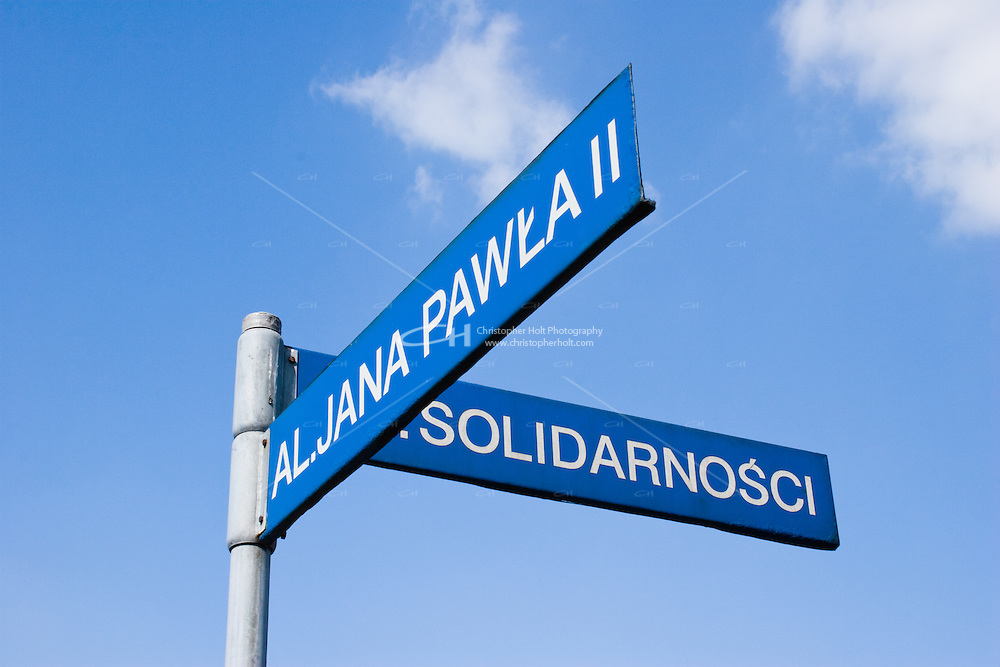 Road sign showing Pope John Paul II and Solidarity street names in Nowa Huta Krakow Poland