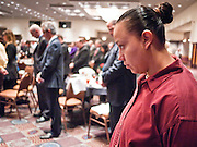 tucsonshooting - 11 JANUARY 2011 - TUCSON, AZ: Sandra Valenzuela observes a moment of silence during the Governor's appearance in Tucson Tuesday.  ARIZONA REPUBLIC PHOTO BY JACK KURTZ mass shooting Gabrielle Giffords shooting