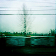 The gray sky and industrial location made a grim landscape devoid of people but filled with evidence of their presence.