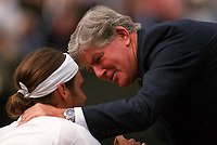 After winning the match and breaking down into tears Mens Champions Roger Federer is congratulated and consoled by Wimbledon Referee Alan Mills. Wimbledon Tennis Championship, Day 13, 6/07/2003. Credit: Colorsport / Matthew Impey