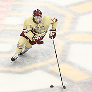 Steven Santini #6 of the Boston College Eagles with the puck during The Beanpot Championship Game at TD Garden on February 10, 2014 in Boston, Massachusetts. (Photo by Elan Kawesch)