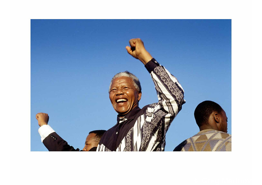 A portfolio of 41 color images of the South African transition from apartheid to democracy