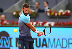 May 8, 2018 - Madrid, Spain - Damir Džumhur of Bosnia Herzegovina plays a backhand to Juan Martin del Potro of Argentina in the 2nd Round match during day four of the Mutua Madrid Open tennis tournament at the Caja Magica. (Credit Image: © Manu Reino/SOPA Images via ZUMA Wire)