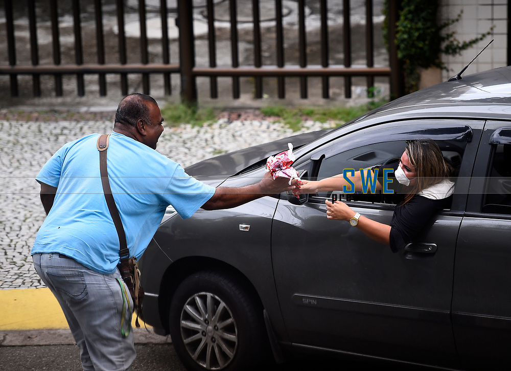 Rio de Janeiro- BrazilApril 12, 2020, Easter with covid19, people deliver Easter eggs with masks