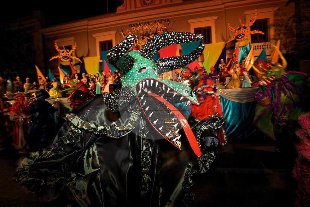 A costumed reveler called a vejigante dances in the streets during the Carnaval de Ponce February 21, 2009 in Ponce, Puerto Rico. Vejigantes are a folkloric character representing the devil.
