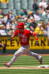 OAKLAND, CA - APRIL 13:  Mike Trout #27 of the Los Angeles Angels of Anaheim rounds third base to score a run against the Oakland Athletics during the third inning at the Coliseum on April 13, 2016 in Oakland, California. The Los Angeles Angels of Anaheim defeated the Oakland Athletics 5-1. (Photo by Jason O. Watson/Getty Images) *** Local Caption *** Mike Trout