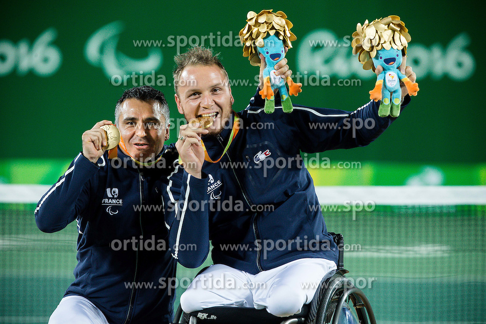 Stephane Houdet (L) and Nicolas Peifer of France celebrate at Victory ceremony after winning against Alfie Hewett (out of frame) and Gordon Reid (out of frame) of the UK in the Tennis Men's Doubles Gold Medal Match during Day 8 of the Rio 2016 Summer Paralympics Games on September 15, 2016 in Olympic Tennis Centre, Rio de Janeiro, Brazil. Photo by Vid Ponikvar / Sportida