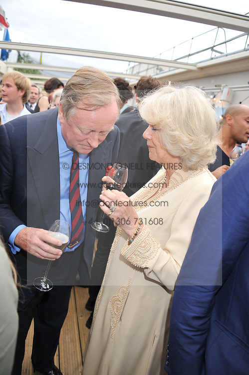HRH the DUCHESS OF CORNWALL and her former husband ANDREW PARKER BOWLES at a party to celebrate the publication on 'Let's Eat: Recipes From My Kitchen Notebook' by Tom Parker Bowles held at Selfridge's Rooftop. Selfridge's, Oxford Street, London on 27th June 2012.