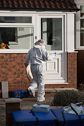 © Licensed to London News Pictures . 17/01/2015 . Stockport , UK . A forensic scenes of crime examiner enters 28 Meadway Road , Cheadle Hulme , Stockport this afternoon (Saturday 17th January 2015 ) after a woman and a man - named as magistrate Yvonne Davies and her husband Andrew - were found dead inside after an apparent murder-suicide last night (16th January 2015) .  Photo credit : Joel Goodman/LNP