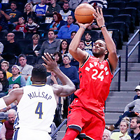 01 November 2017: Toronto Raptors forward Norman Powell (24) takes a jump shot over Denver Nuggets forward Paul Millsap (4) during the Denver Nuggets 129-111 victory over the Toronto Raptors, at the Pepsi Center, Denver, Colorado, USA.