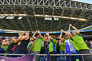 Seattle Sounders fans stand and cheer before the MLS soccer match against the LA Galaxy on Saturday, September 1, 2019, in Seattle, Washington. (Alika Jenner/Image of Sport via AP)