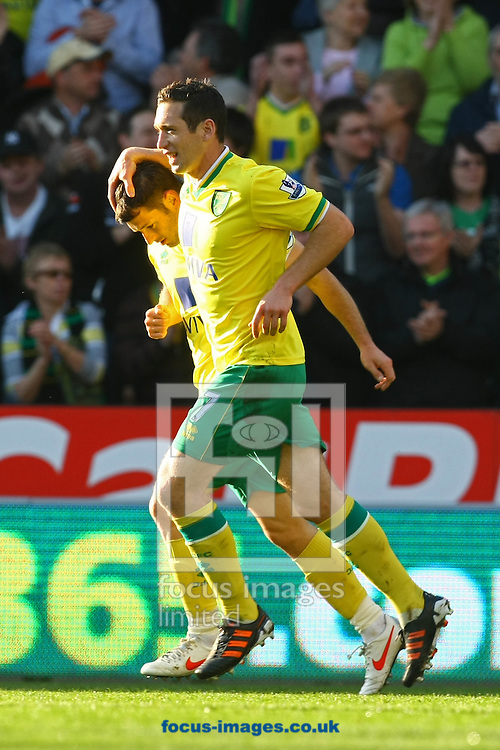 Picture by Paul Chesterton/Focus Images Ltd.  07904 640267.11/03/12.Andrew Crofts of Norwich pats Wes Hoolahan of Norwich on the head after he scores his sides 1st goal during the Barclays Premier League match at Carrow Road Stadium, Norwich.